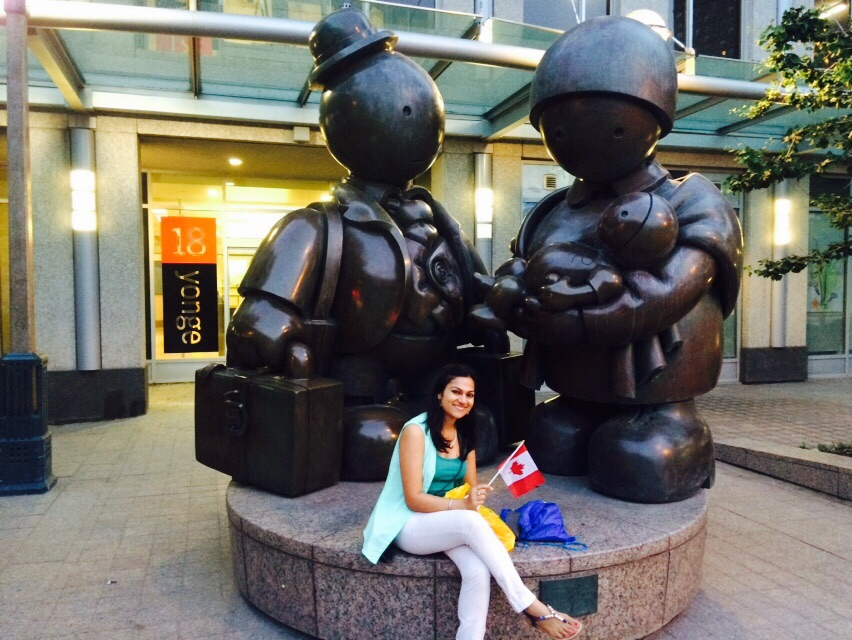 With an Immigrant Statue in Downtown Toronto